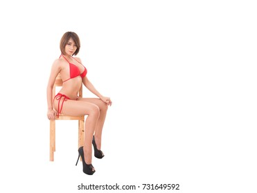 isolated red bikini girl sitting on a chair.