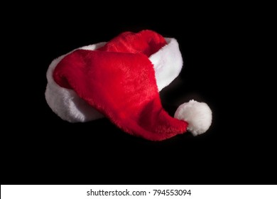 isolated red christmas cap on black ground
