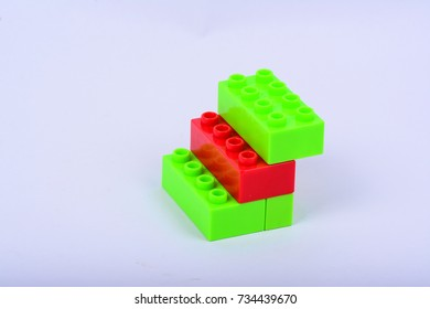Isolated red and green toy blocks on white background.