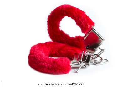 Isolated red handcuffs
