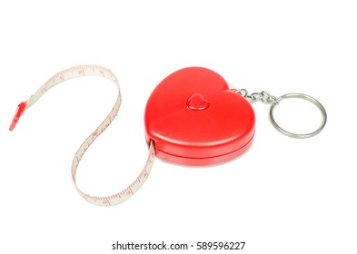 Isolated red heart measuring tape