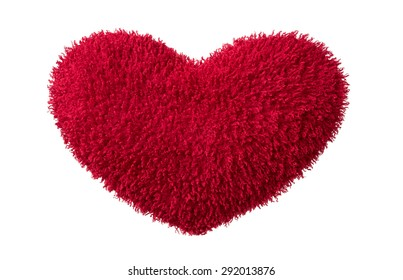 A isolated red plush  heart on white background