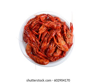 isolated red raw crayfish on white plate with clipping path, top view