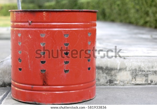 Isolated of a red steel tanks for burning golden or silver color money paper of chinease to Predecessor of Chinease people