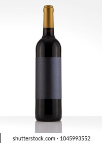 Isolated Red Wine Bottle in a White and Wood Background, fresh and Clean with Gold Capsule with Black Label
