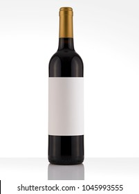 Isolated Red Wine Bottle in a White and Wood Background, fresh and Clean with Gold Capsule with White Label