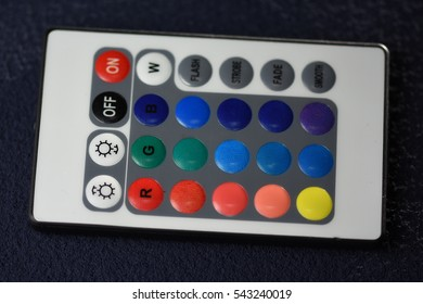 isolated remote controller for LED Strip Light on black background