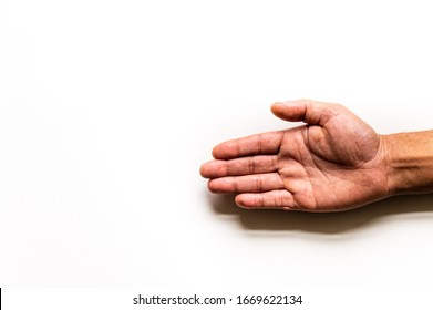 An isolated  right hand reaches in frame right with palm open  on a white background with copy space.
