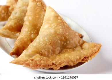 Isolated samosa on white background, Ramadan iftar meal, Ramzan dinner, Eid party refreshment .
