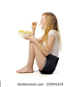 Isolated seated young woman eating some chips