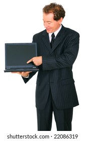 isolated senior businessman looking and pointing at laptop
