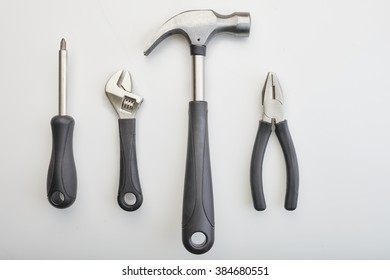 Isolated set of metal working tools, wrench, hammer, screwdriver, locking pliers