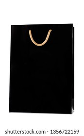 Isolated shopper wine bag total black with golden handle