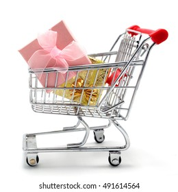 Isolated shopping cart with gift boxes