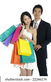 Isolated shopping couple smiling