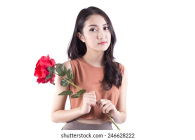 An isolated shot of an asian girl holding a bouquet of red roses celebrating Valentine day
