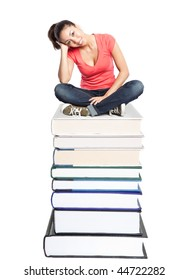 An isolated shot of a beautiful black college student sitting on a stack of books