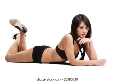 An isolated shot of a beautiful sexy asian girl in lingerie lying down on the floor