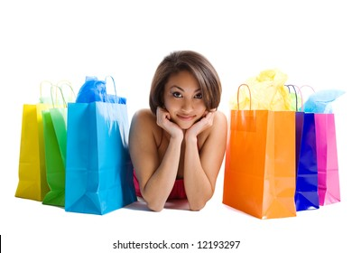 An isolated shot of a black woman with shopping bags