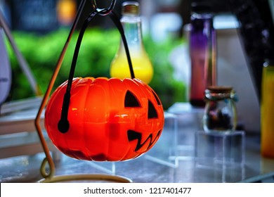 Isolated shot of a candy container with scary pumpkin design due to holloween celebration.Soft focus effect due to large aperture setting.