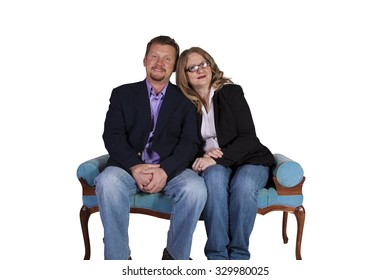 Isolated shot of a couple sitting on an antique chair - white background