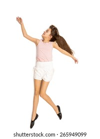 Isolated shot of cute girl dancing and jumping high