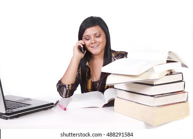 Isolated Shot of a Cute Woman Studying at her Desk