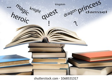 An isolated shot of educational books with one being spread open to show words jumping off the page.