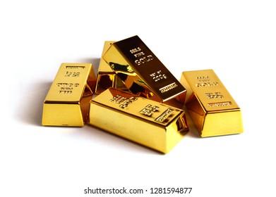 Isolated shot of five stacked 999 fine gold ingot bullion bars.