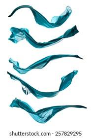 Isolated shot of freeze motion of blue silk, isolated on white background