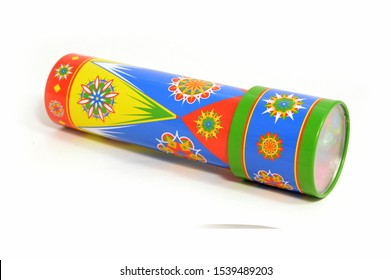 An isolated shot of a kids kaleidoscope toy used for making abstract views when looking in the viewfinder.