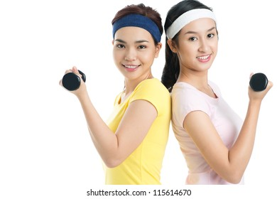 Isolated shot of lovely females working out with dumbbells
