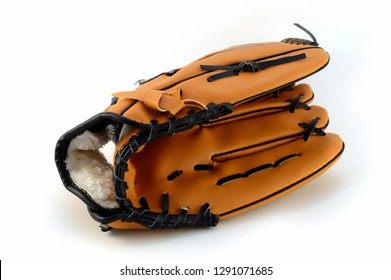An isolated shot of a new baseball glove for playing team sports.