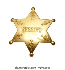 An isolated shot of a sheriff badge.