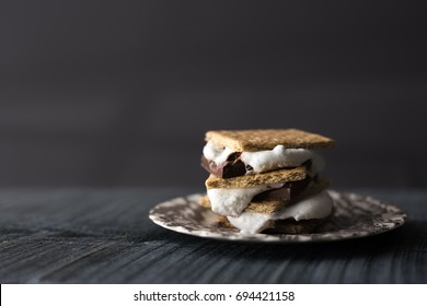 Isolated shot of a s'more chocolate and marshmallow sandwich layered with crunchy graham crackers.