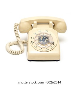 An isolated shot of a traditional rotary phone.