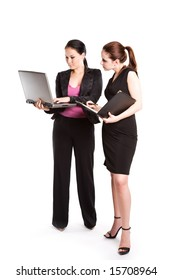 An isolated shot of two businesswomen working together