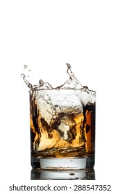 Isolated shot of whiskey with splash on white background