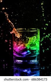 Isolated shot of whiskey with splash on black background