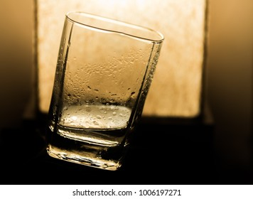 An isolated shot of a whisky glass suspended in space