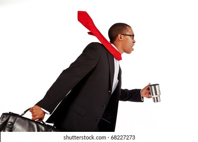Isolated shot of a young businessman running.