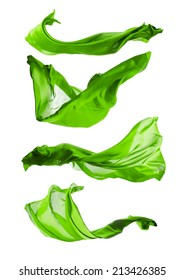 Isolated shots of freeze motion of transparent green silks, isolated on white background
