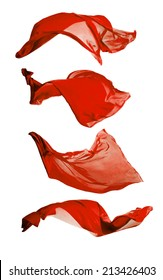 Isolated shots of freeze motion of transparent red silks, isolated on white background