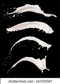 Isolated shots of milk splashes on white background