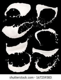 Isolated shots of milk splashes on black background