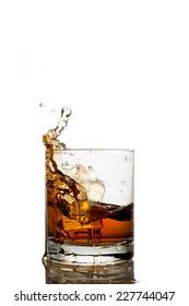 Isolated shots of whiskey with splash on white background