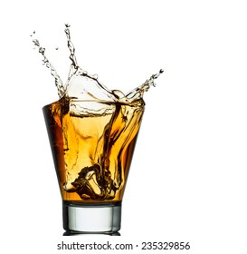 Isolated shots of whiskey with splash on white background