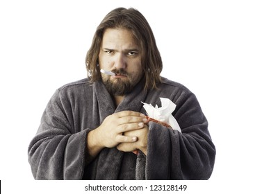 isolated sick man bundled up in a robe taking his temperature