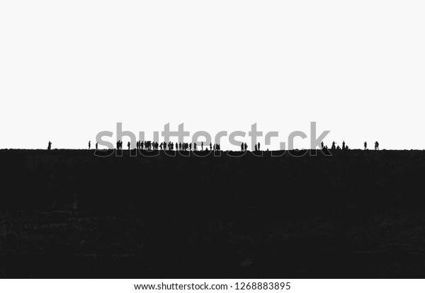 Isolated silhouette of a gathering young people outdoors