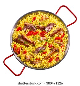 Isolated single pan full of spare ribs and yellow rice garnished with red bell pepper slices in pan